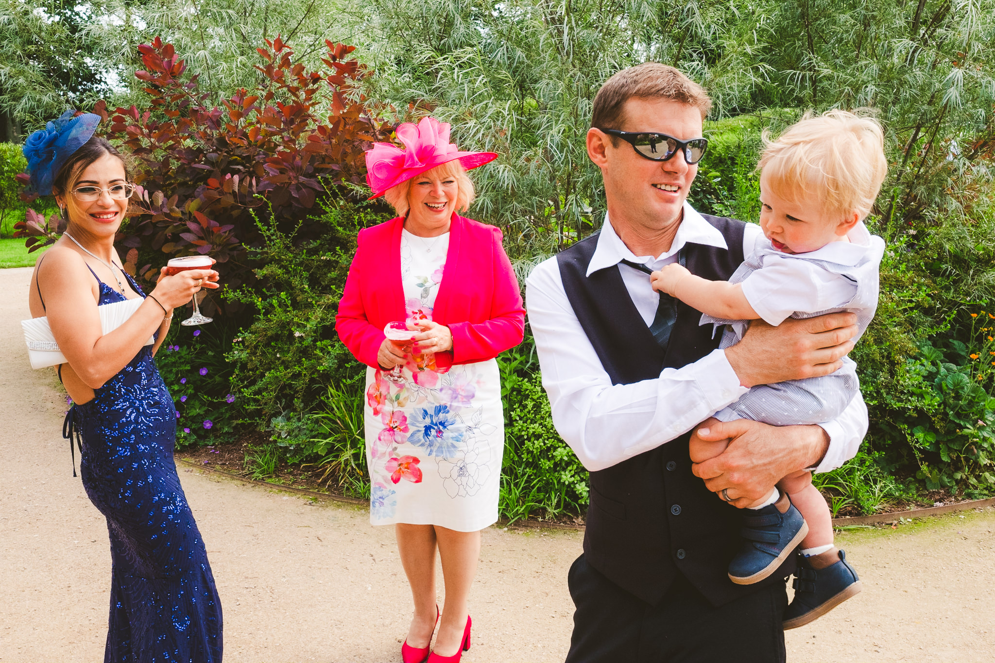 Wedding guests enjoying the sun at Newton Hall