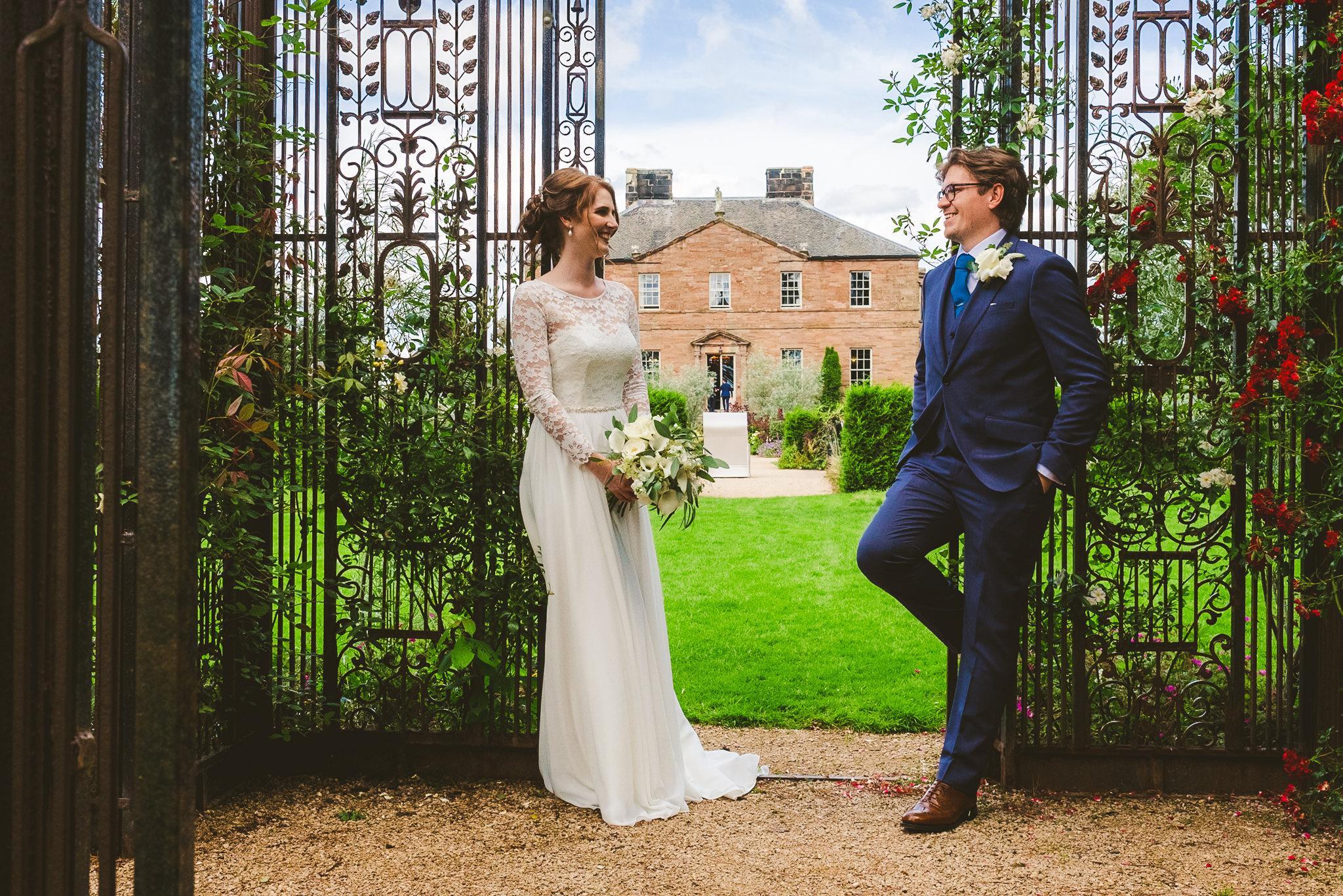 Bride a groom pose in the garden of Newton Hall