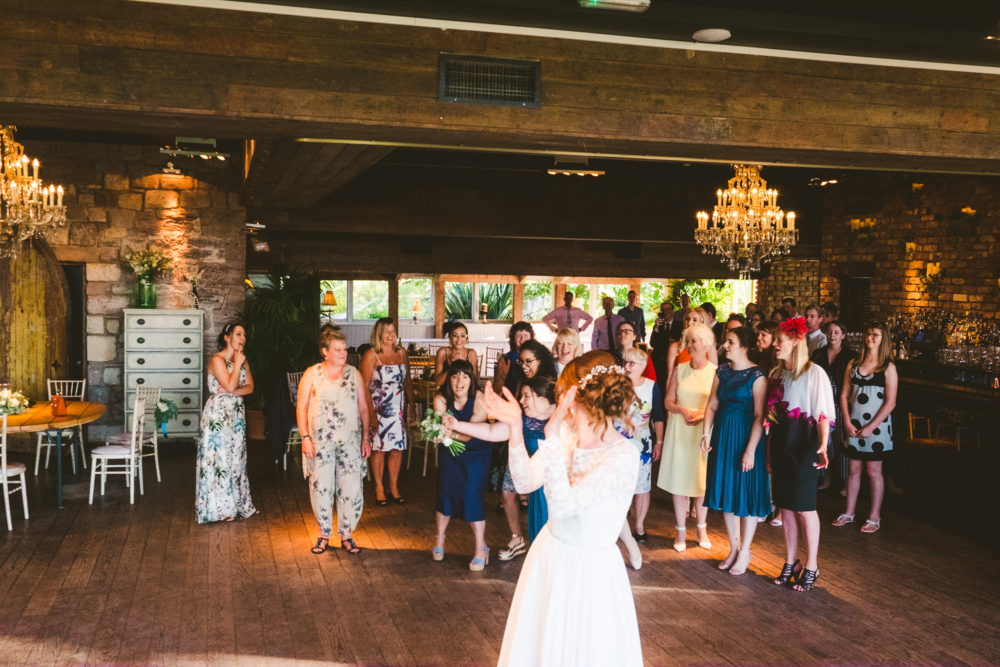 Bouquet toss in the Garden Suite at Newton Hall
