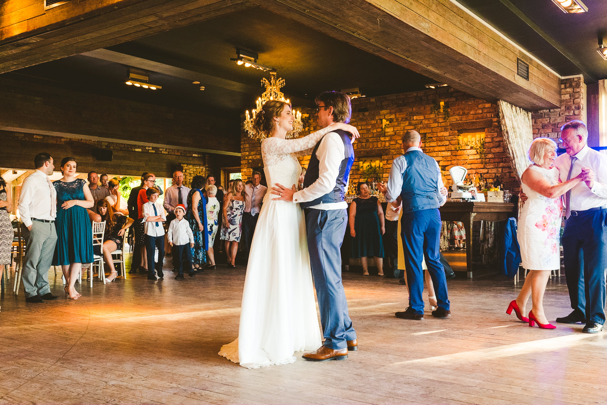 Bride and groom first dance in the Garden Suite at Newton Hall