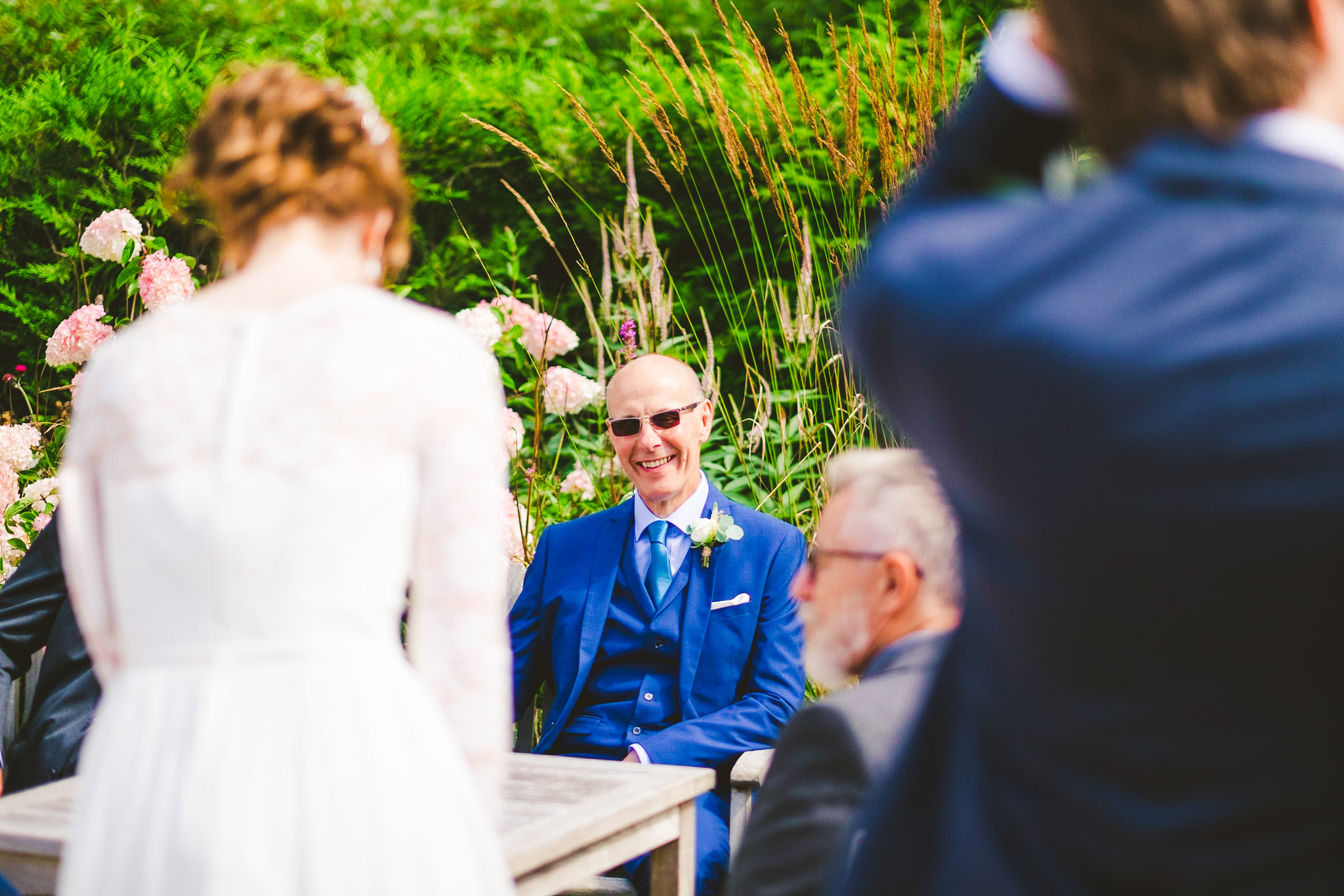 The father of the bride laughs at the bride's joke