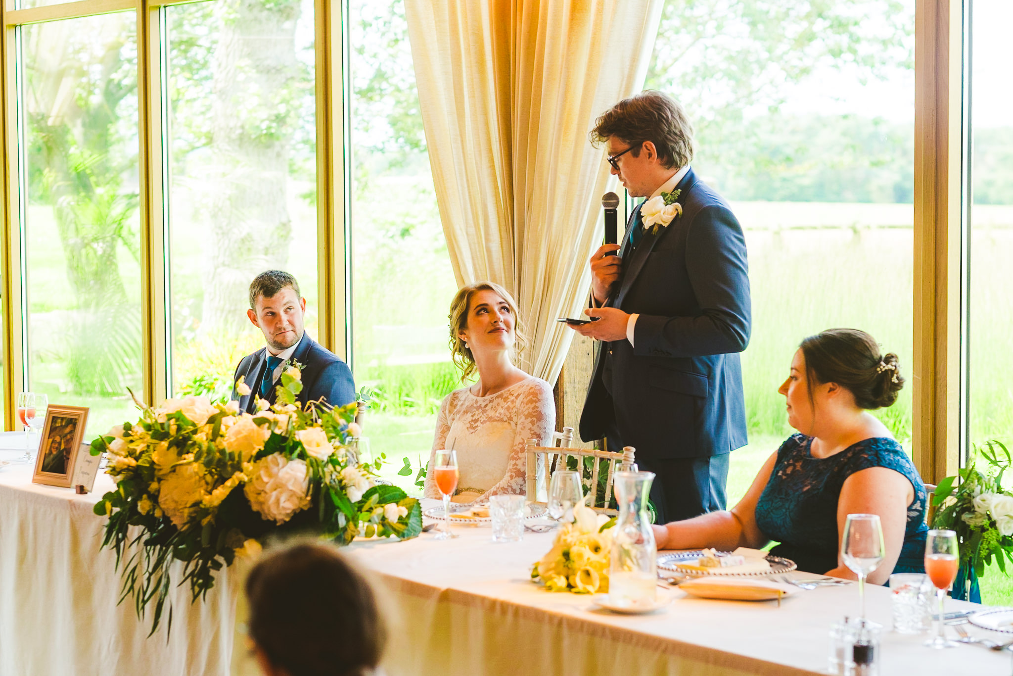 Groom speaks to bride during wedding speech