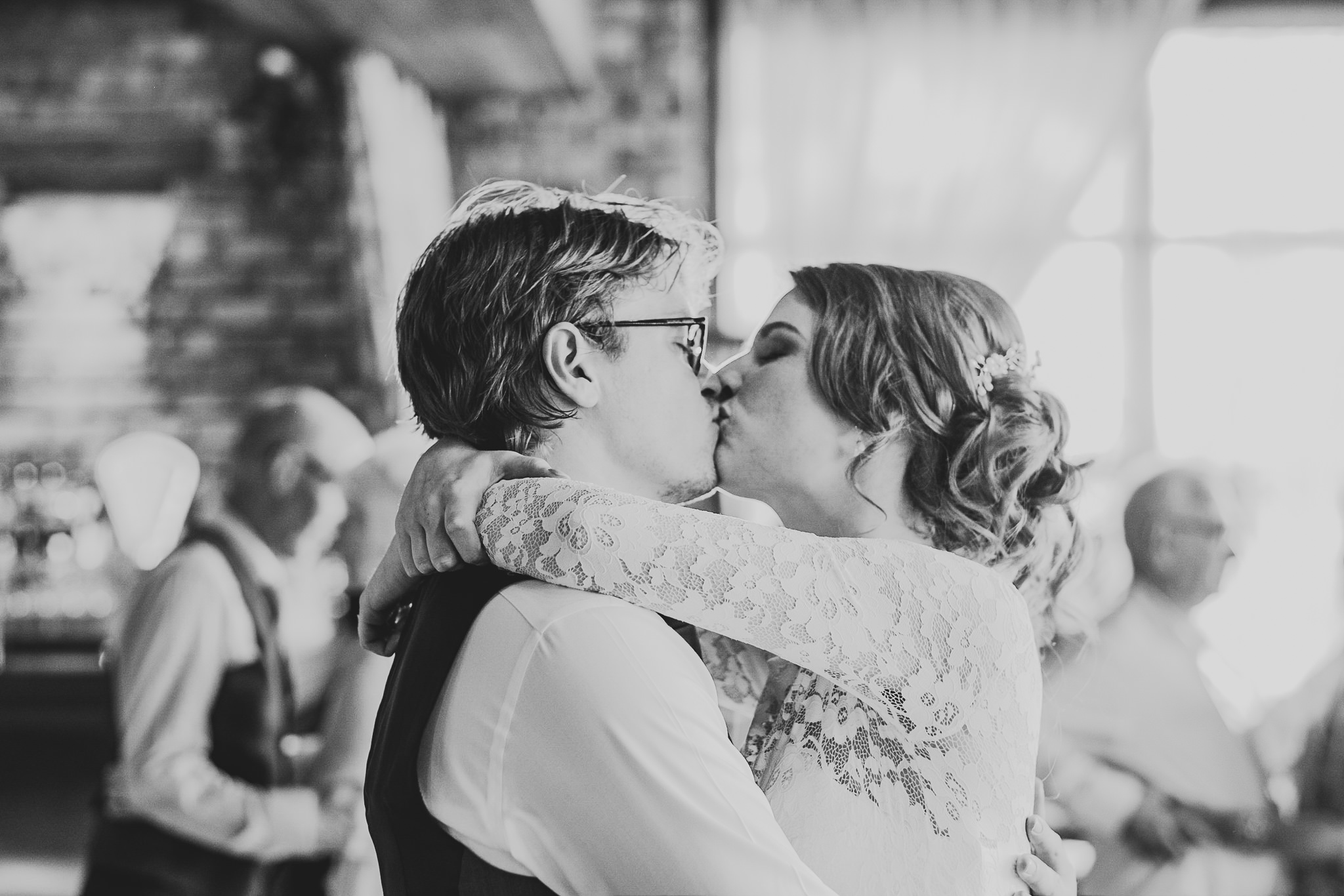 Kiss during the bride and groom first dance at Newton Hall