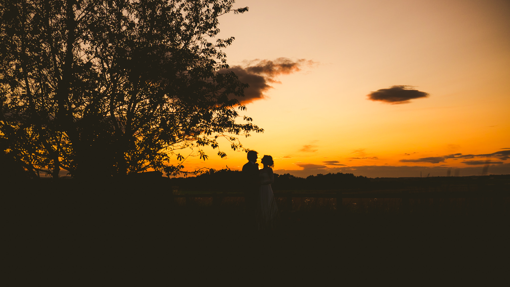 Silhouette of couple at sunset at Newton Hall
