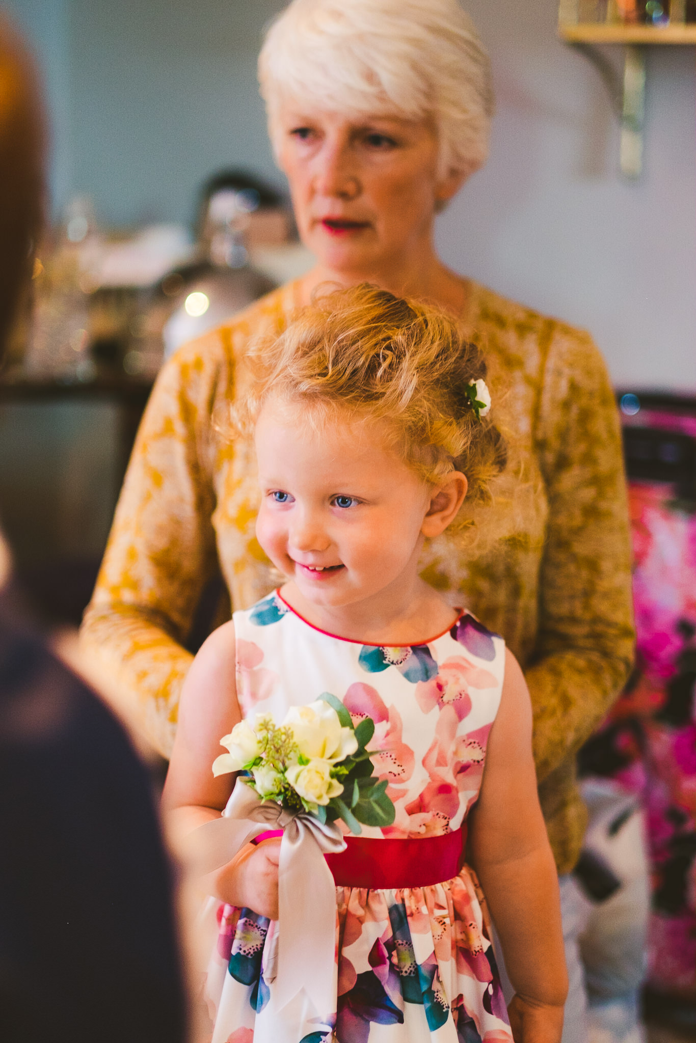 Mother of the bride getting flower girl ready