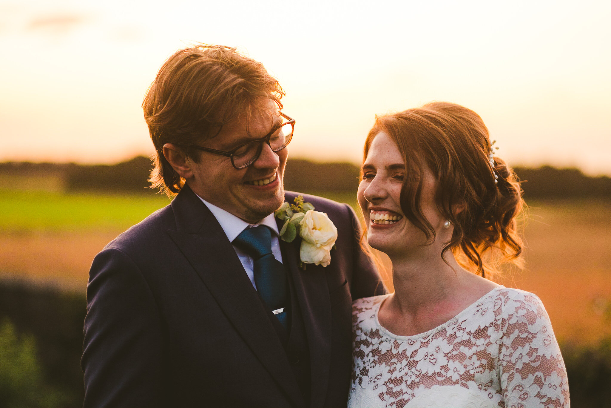 Andrew and Alice at sunset on their wedding day at Newton Hall in Northumberland
