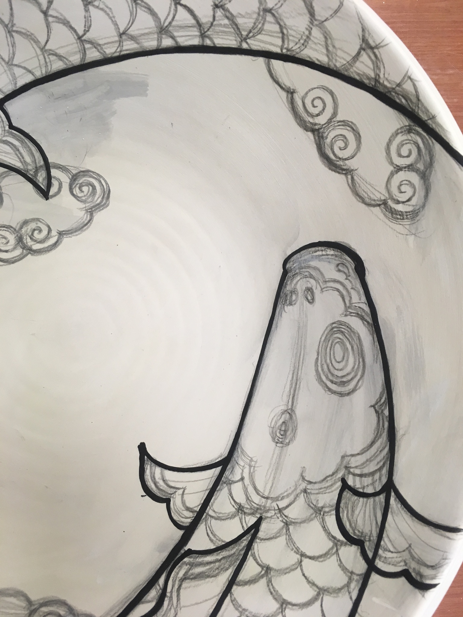 Start applying the underglaze lines by a brush. I can scrape off the mistakes with a sharp tool.
