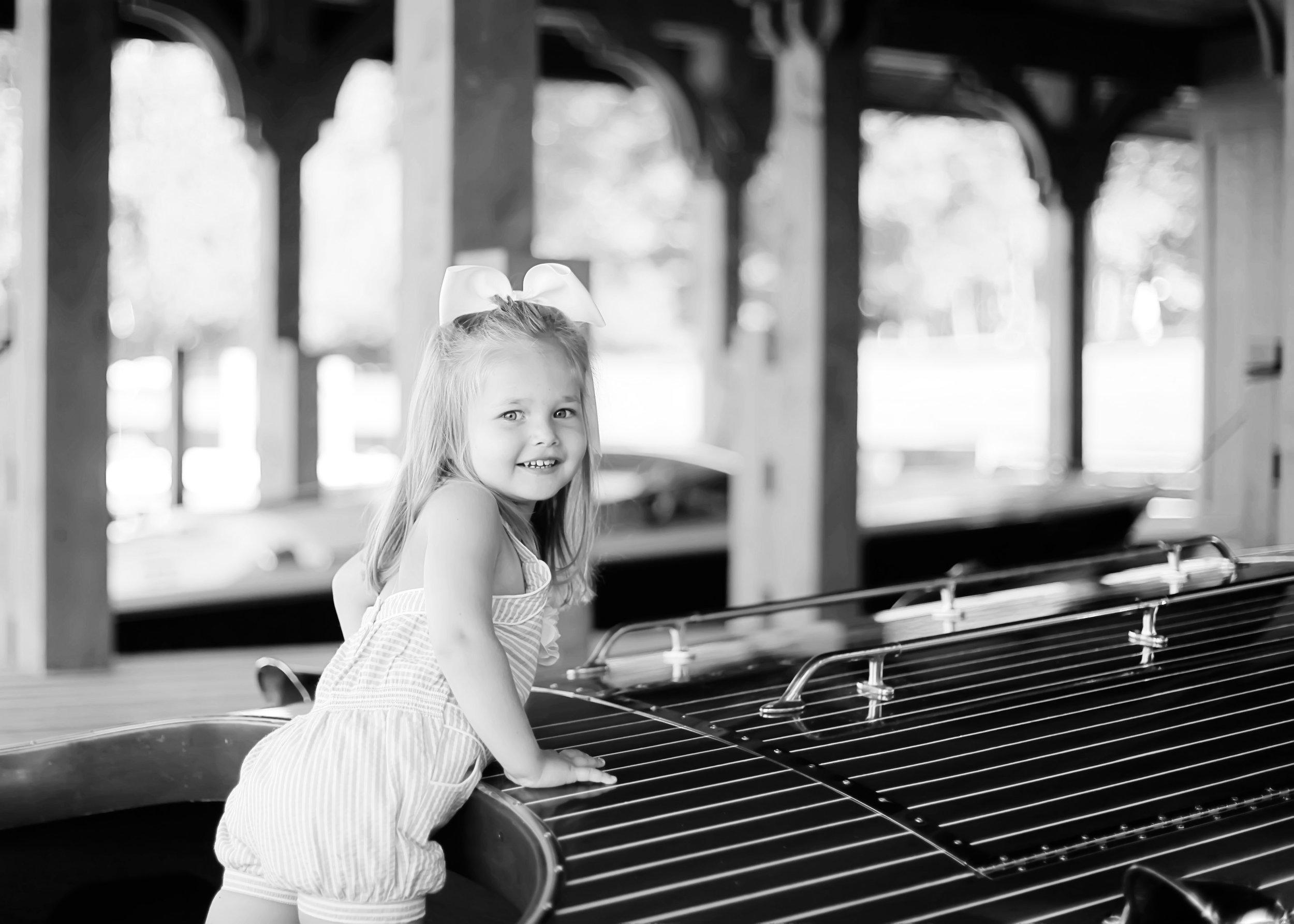 girl on wooden boat.jpg