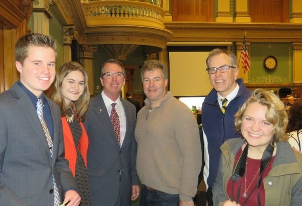 Evan Ochsner, Savannah Olmstead, Rep. Lundeen, Don Olmstead, Tom Patrick and Holly Knutsen on the floor of the House.