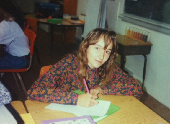 12-year-old me in class with Elaine sitting behind me.