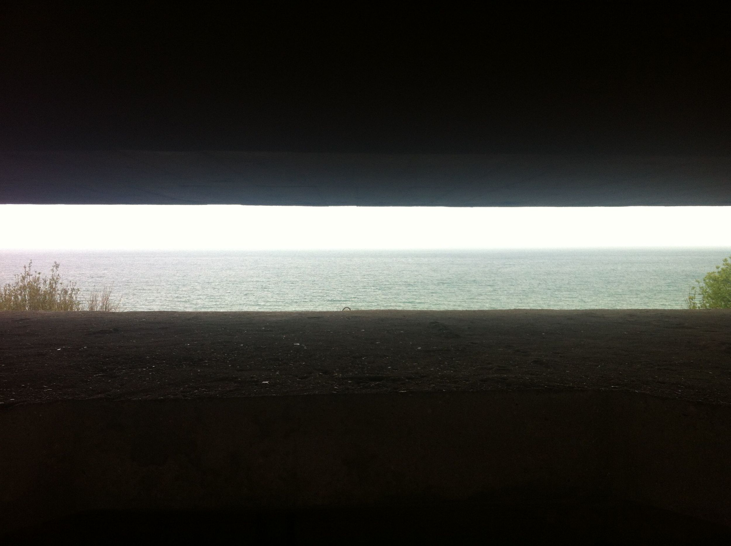 View of Gold Beach from inside German bunker.