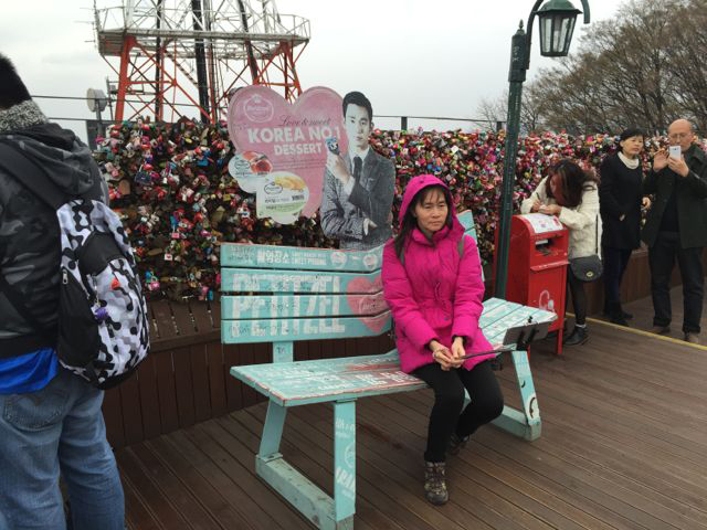 Love benches atop Namsan, where shy lovers are forced to get closer (selfie sticks are HUGE in Korea) (©Deborah Clague/Oblada.com).