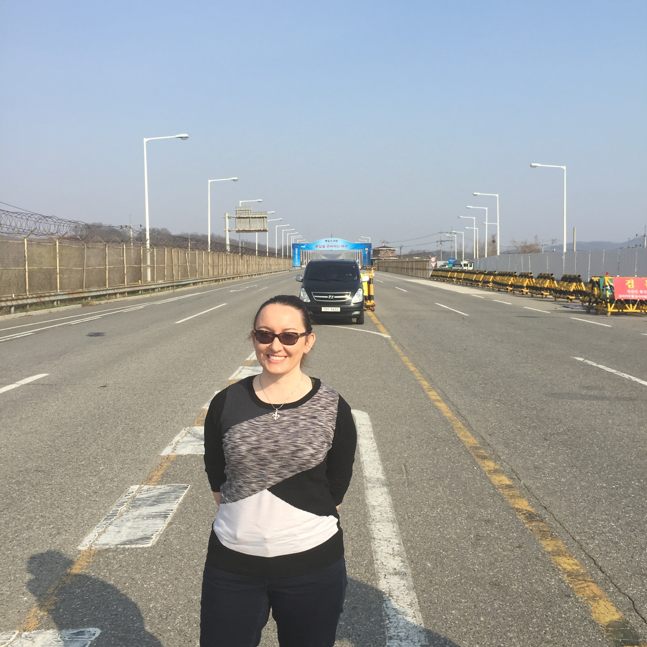 Me standing at the heavily fortified border crossing between North and South Korea (2015).
