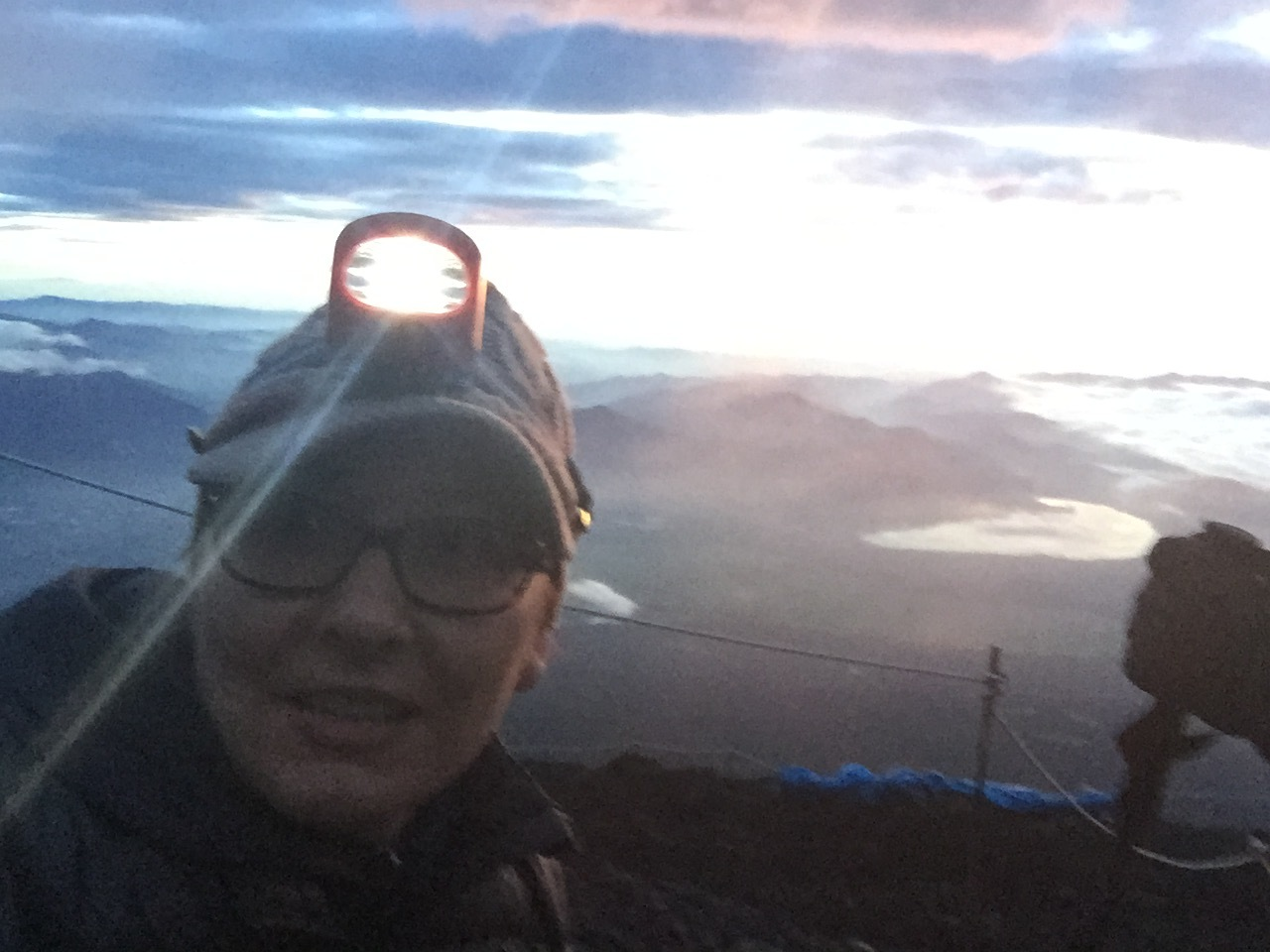 Me watching the sunrise over Japan from the summit of Mount Fuji. I CLIMBED A FREAKIN' MOUNTAIN (2015)!!!