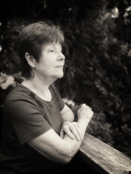 Lynne (June 2017).  My close friendships are a very tight circle, but they run deep.Few people know me better than this lovely woman.What started as a work arrangement has ended up being a lasting friendship spanning almost twenty years. With all portraits, I try to capture a bit of the subject's essence as I see them. Within her beautiful backyard garden, I wanted to capture Lynne in a moment of reflection. For this is how we met (she was creating an award-winning family history book) and how she has helped me throughout the years since.