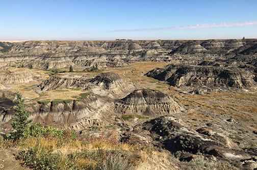 Hiking the jurassic landscape at Horseshoe Canyon near Drumheller, Alberta.