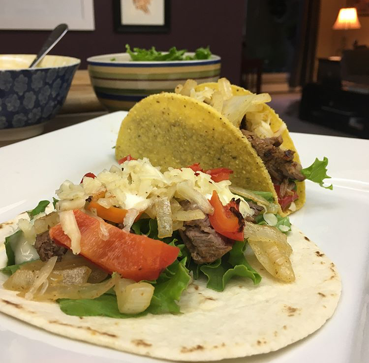 Soft and hard shell steak tacos marinated overnight in raspberry chipotle sauce with grilled onion, red pepper, chillis, lettuce, lime-infused sour cream and shredded habanero cracked pepper cheese made by moi.