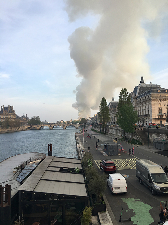 View of Notre-Dame Cathedral fire from Passerelle Léopold-Sédar-Senghor, Paris (©Deborah Clague, 2019).