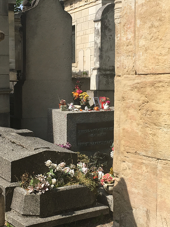 Jim Morrison's infamous gravesite at Pére Lachaise Cemetary in Paris, France (©Deborah Clague, 2019).