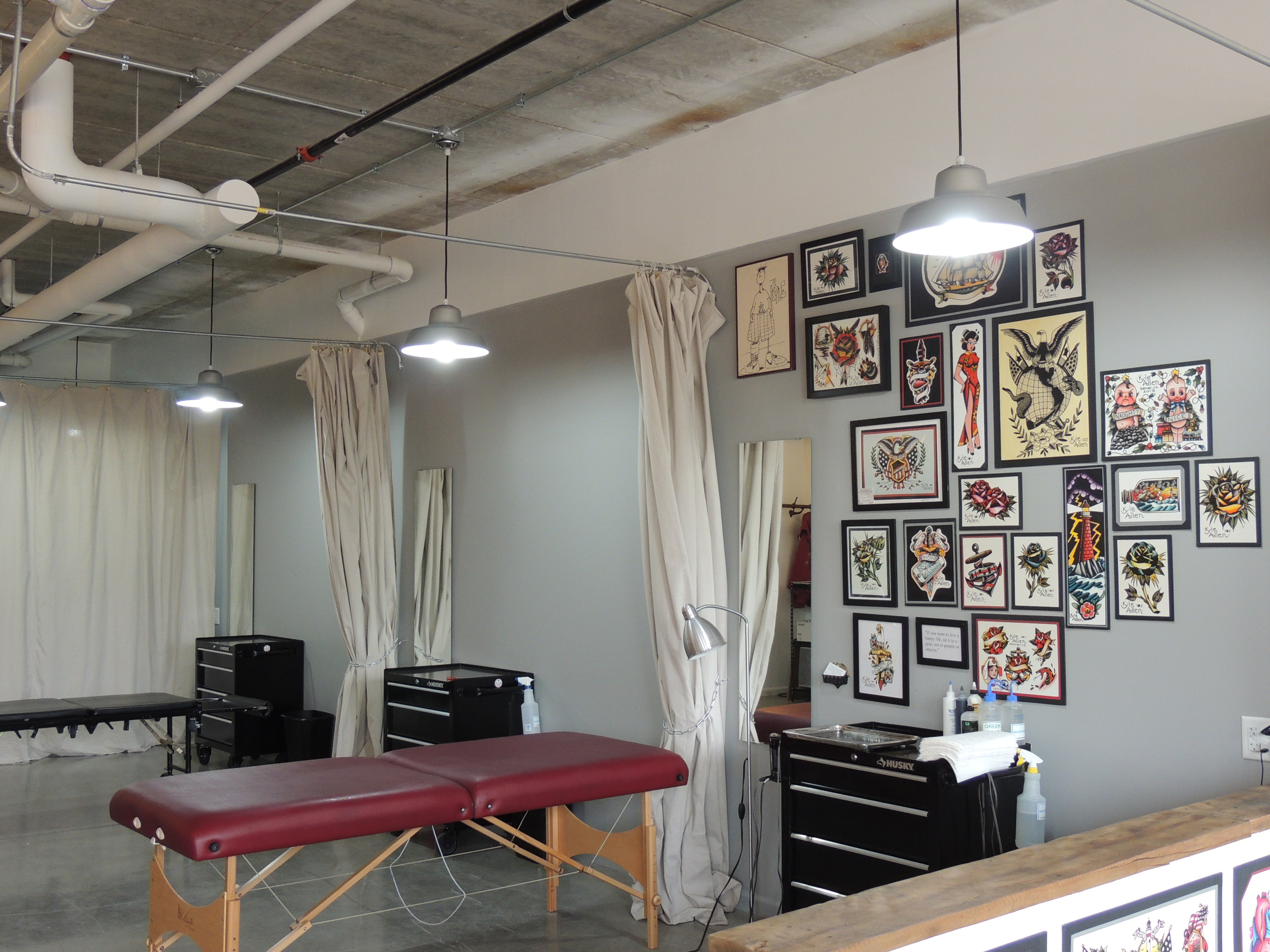 Tattoo parlor space within Benchmark Tattoo and Art Gallery.