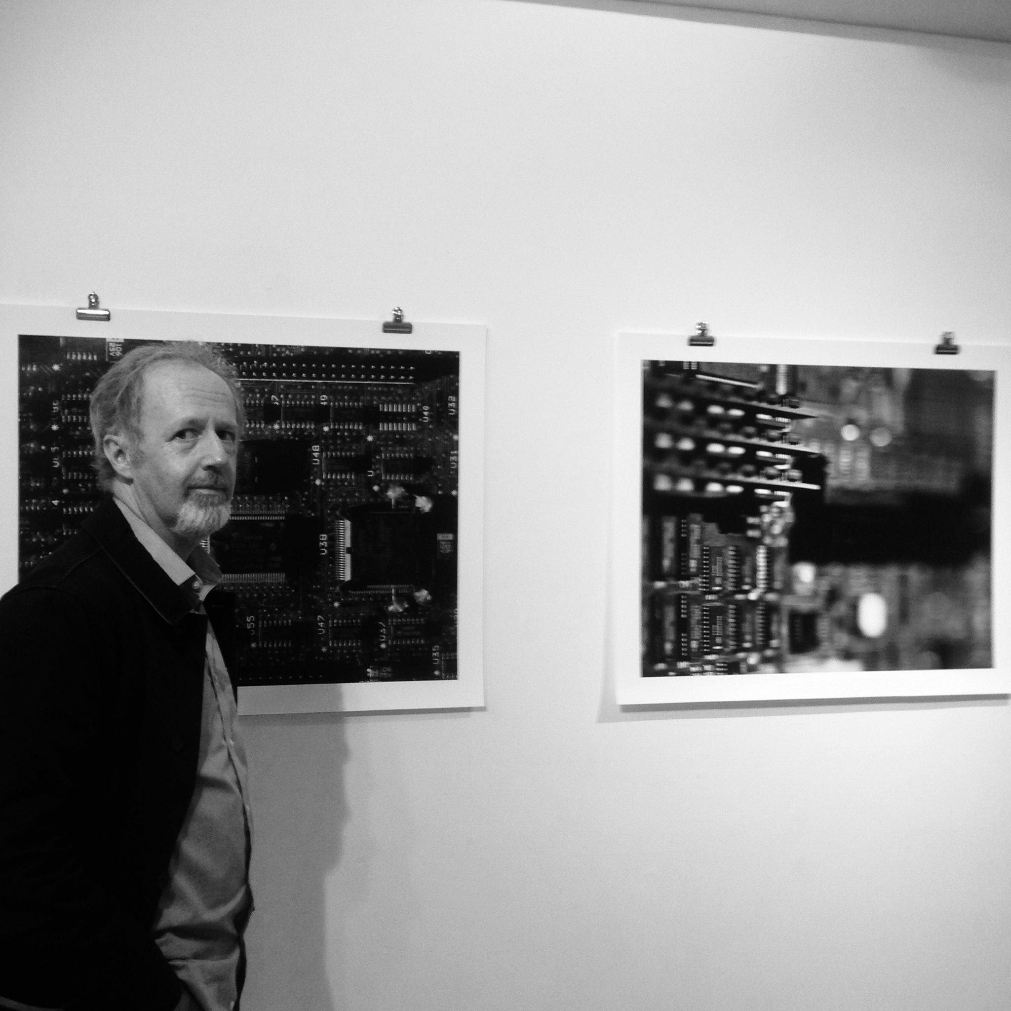 Hugh McCabe at opening of Lost State, with his photographs.