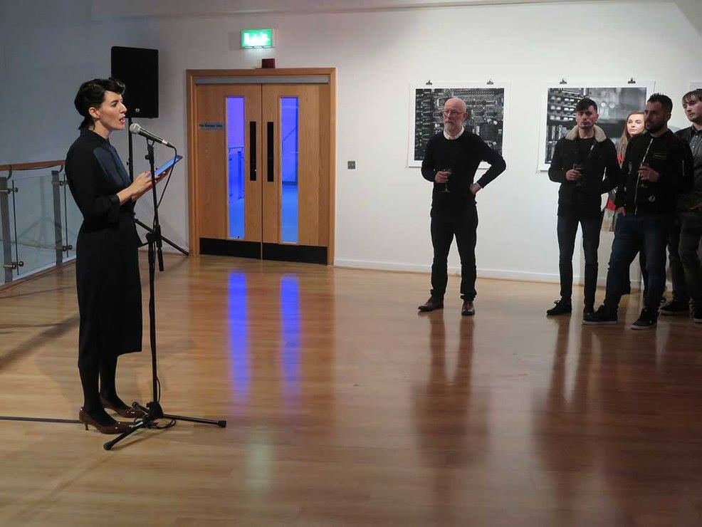 Suzanne Walsh giving performative reading at the opening of Lost State, October 2017.