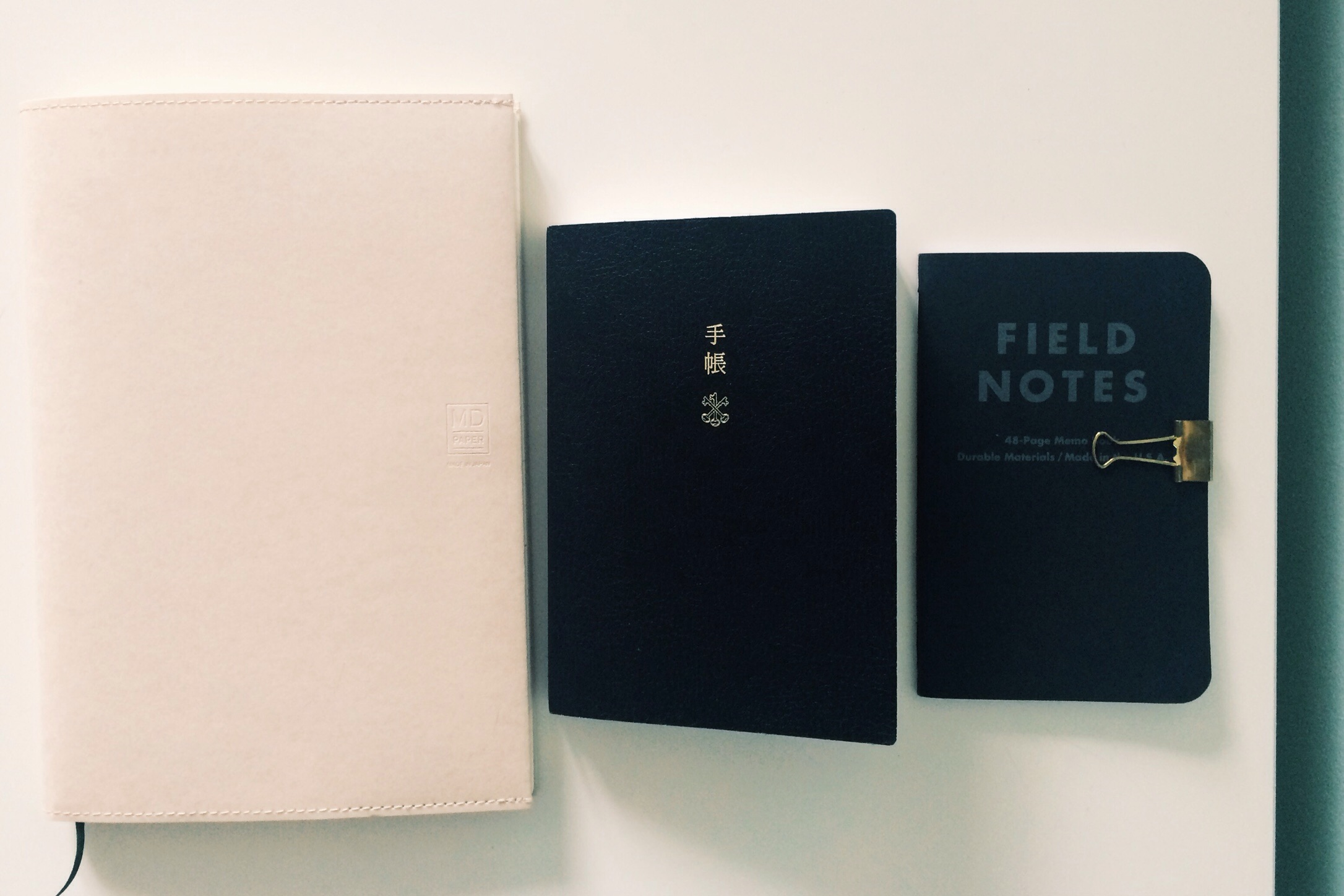 Left to right - Midori MD A5 lined notebook, Hobonichi Techo, Field Notes Pitch Black