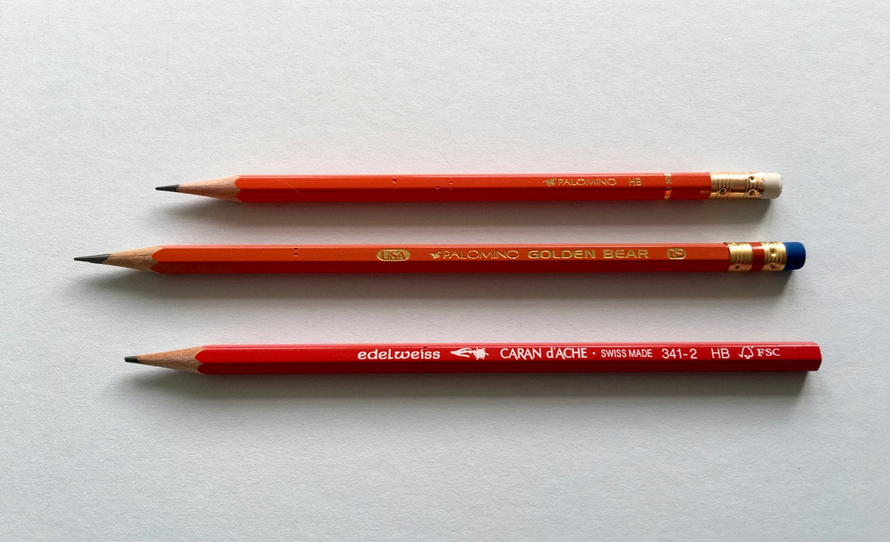 The Palomino HB pencil next to the Golden Bear and a Caran d'Ache, for redness comparison purposes