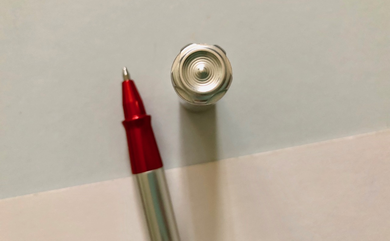 The cog, or more rightly hose, design on the pen cap
