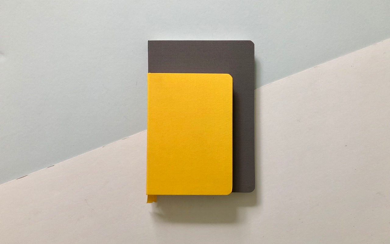 The yellow Confidant in the Flagship (A5ish) size and the charcoal in the Plus size.