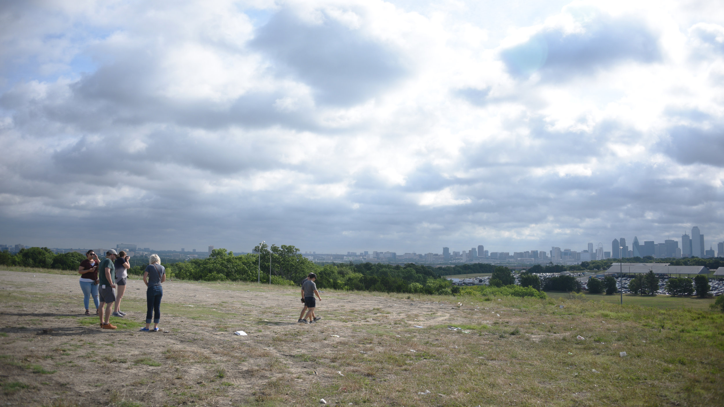 """Outsiders surveying the downtown skyline from the I-30 on-ramp overlook at Hampton Rd. AKA """"El Bordo."""" The first stop along the """"gateways"""" tour."""