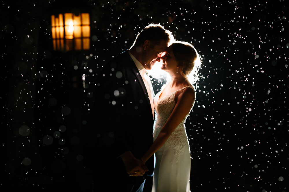 a beautiful wedding at landoll's mohican castle nighttime photograph in the rain