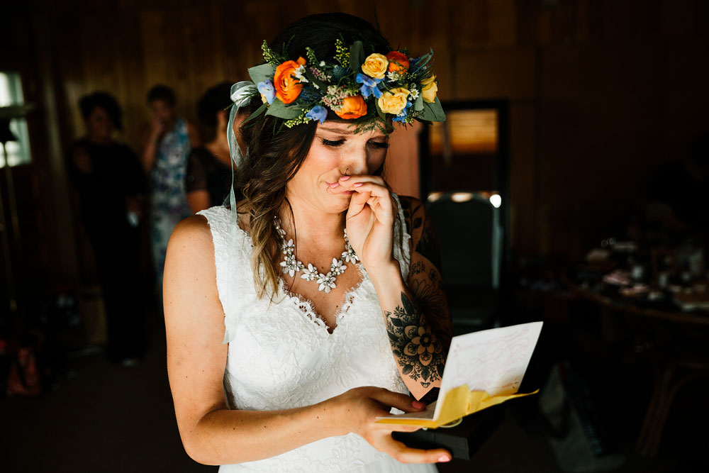 bride crying while reading a letter from her groom