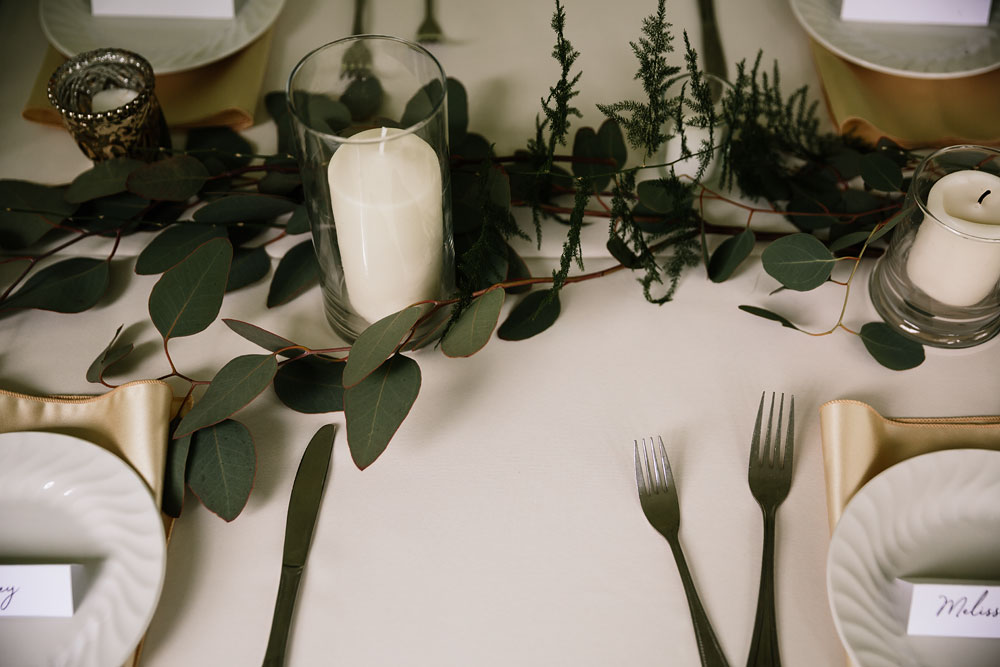 white and green table decorations with candle