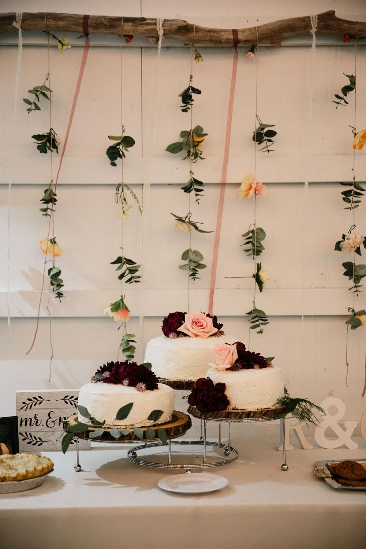 wedding cake maroon pink and green three