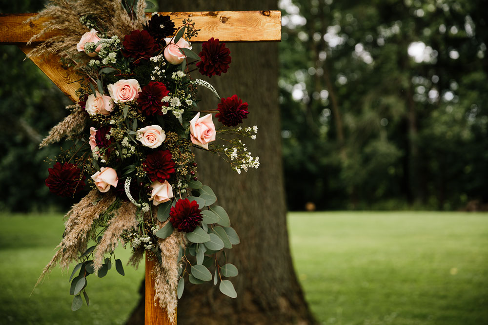 pink red and green wedding decorations flower archway