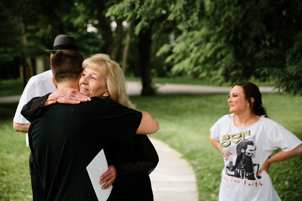 groom hugs mother before his wedding