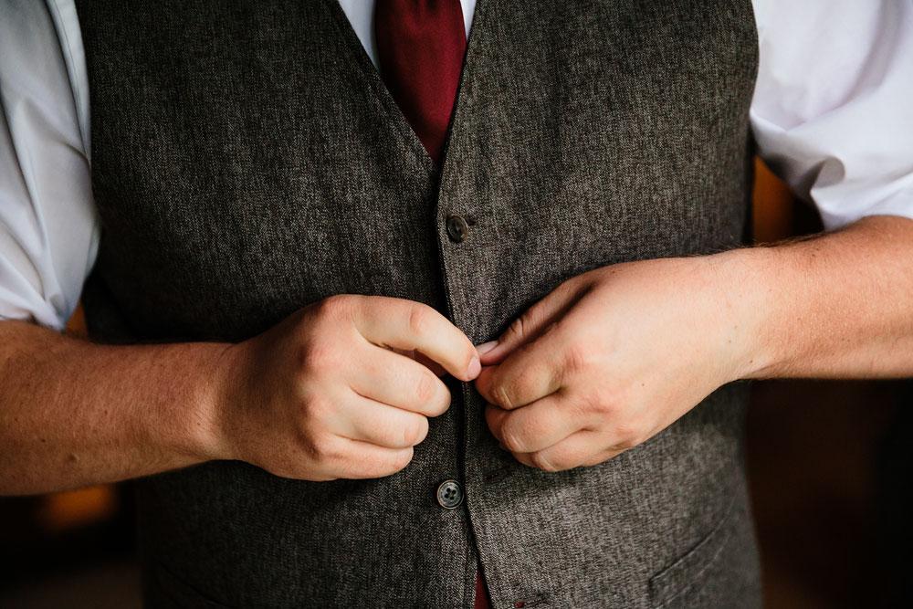 groomsmen buttoning vest
