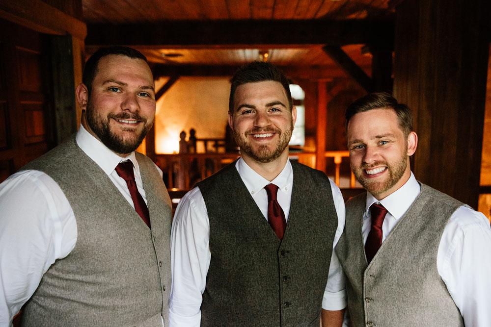 groomsmen and groom smiling