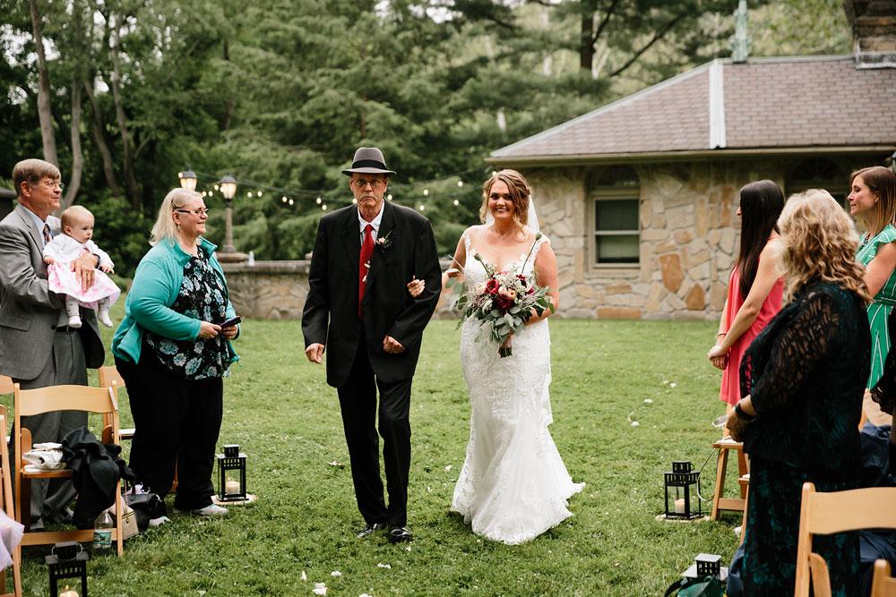 bride and father walk down isle