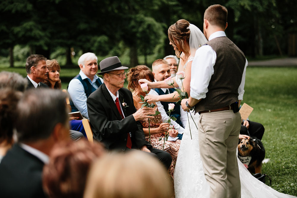 bride gives father a rose