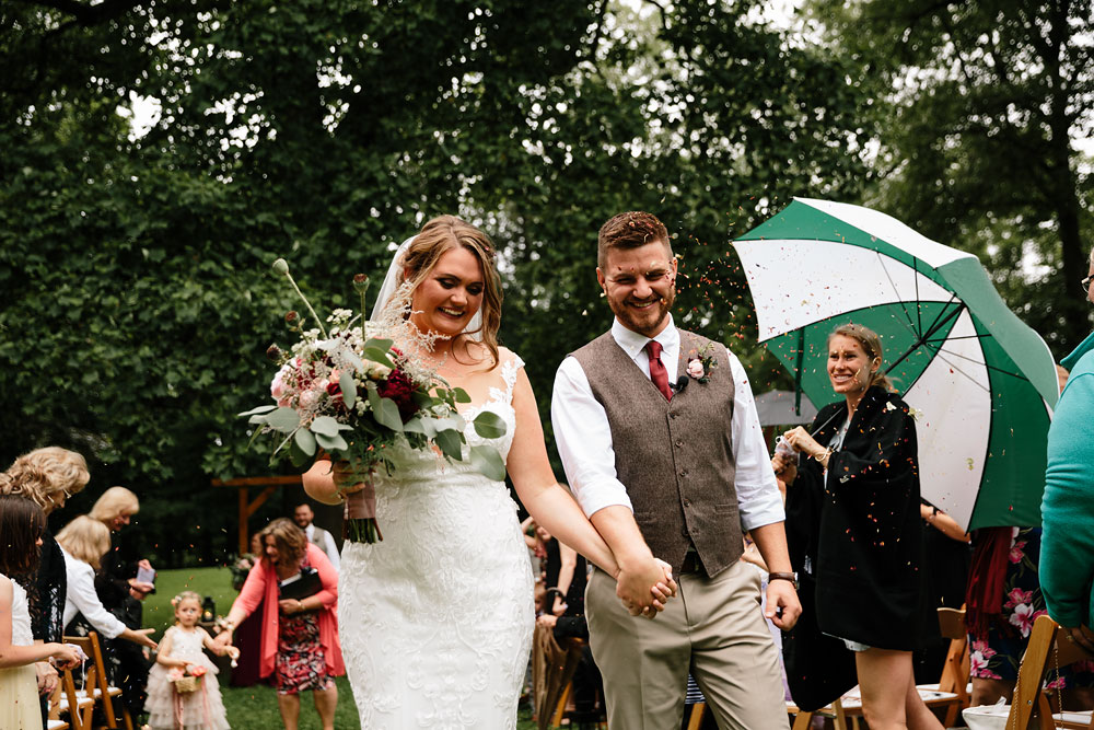 bride and groom walk down isle after ceremony