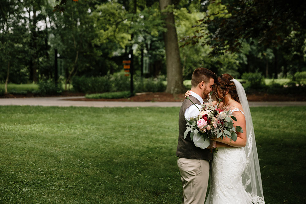 bride and groom hug at wedding at Hines Hill Conference Center in Cuyahoga Valley National Park