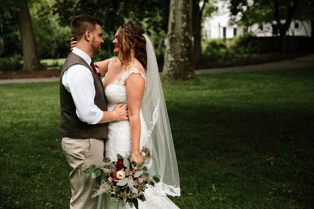 bride and groom smile at each other at wedding at Hines Hill Conference Center in Cuyahoga Valley National Park