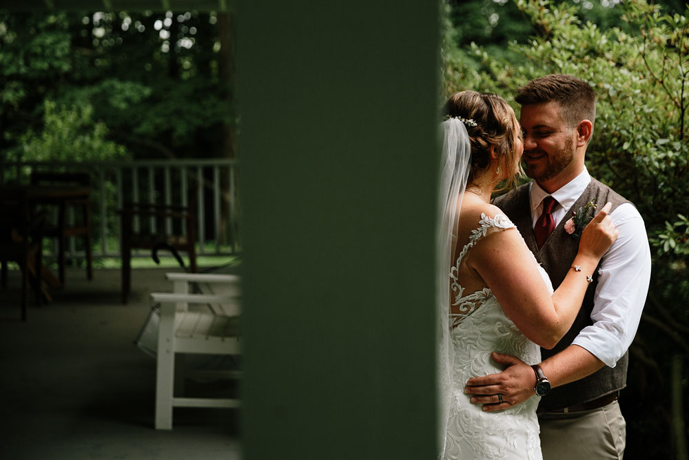 bride and groom hug and smile at each other