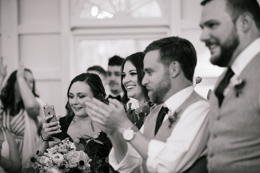 clapping for happy couple