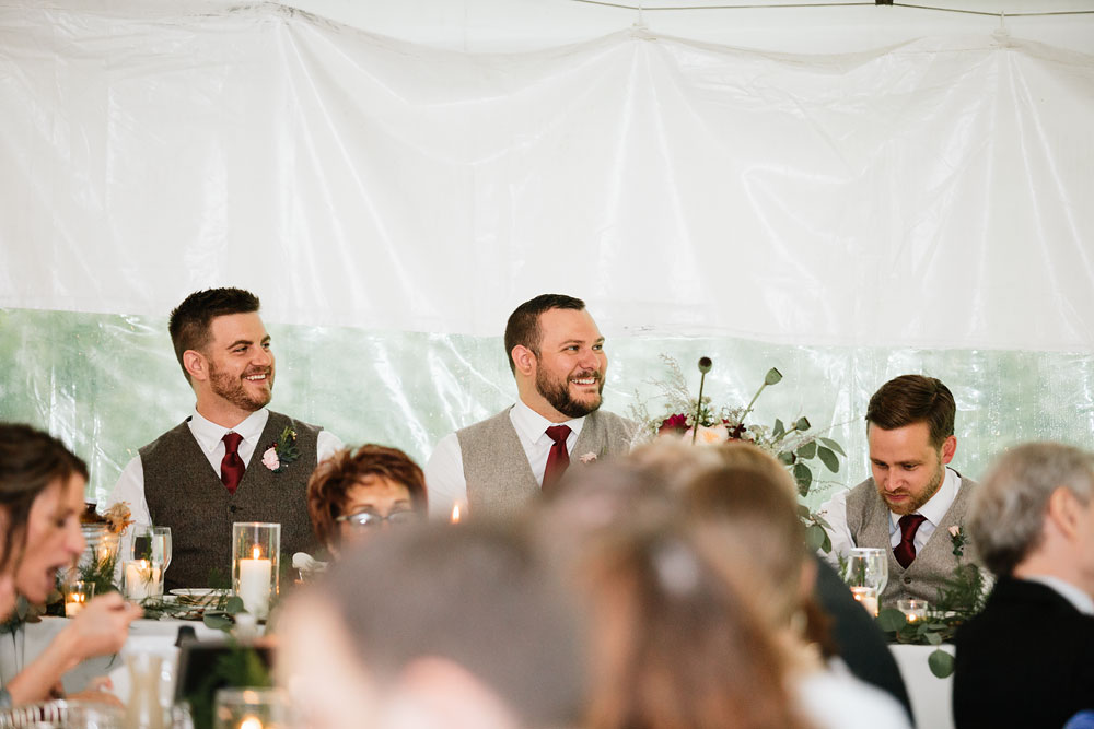 groom and groomsmen smiling at reception