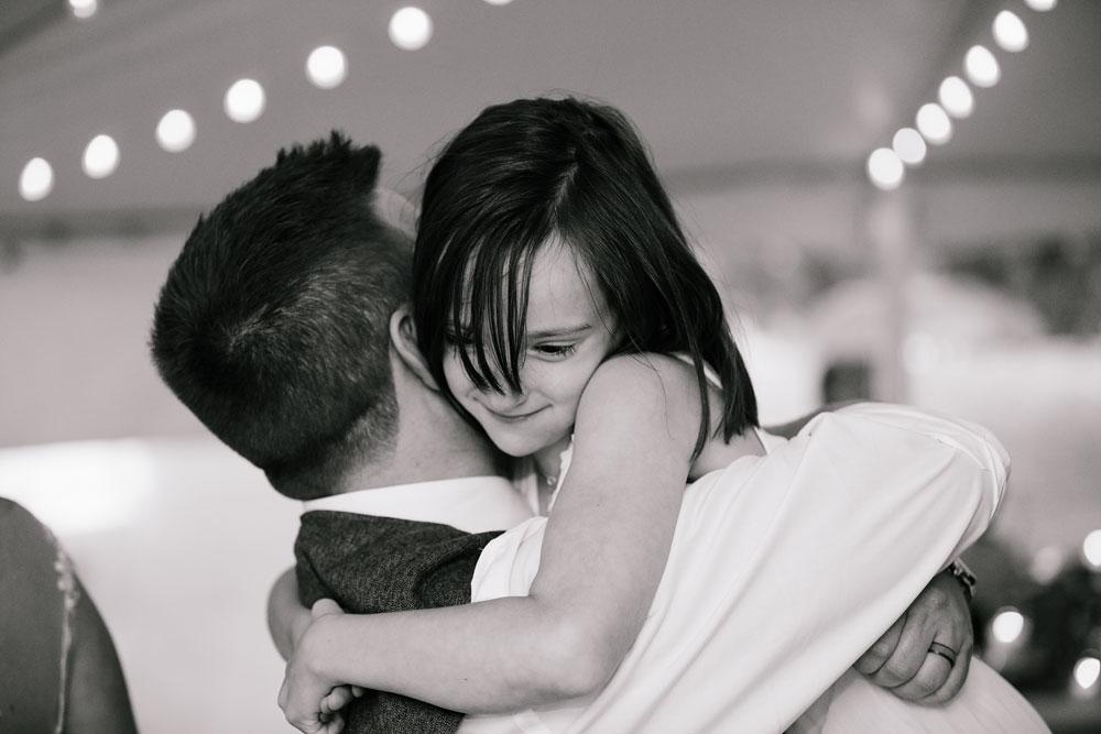 groom hugging little girl