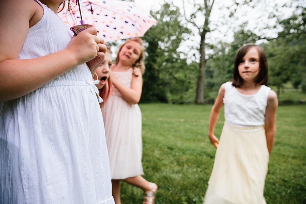 little girls and umbrellas
