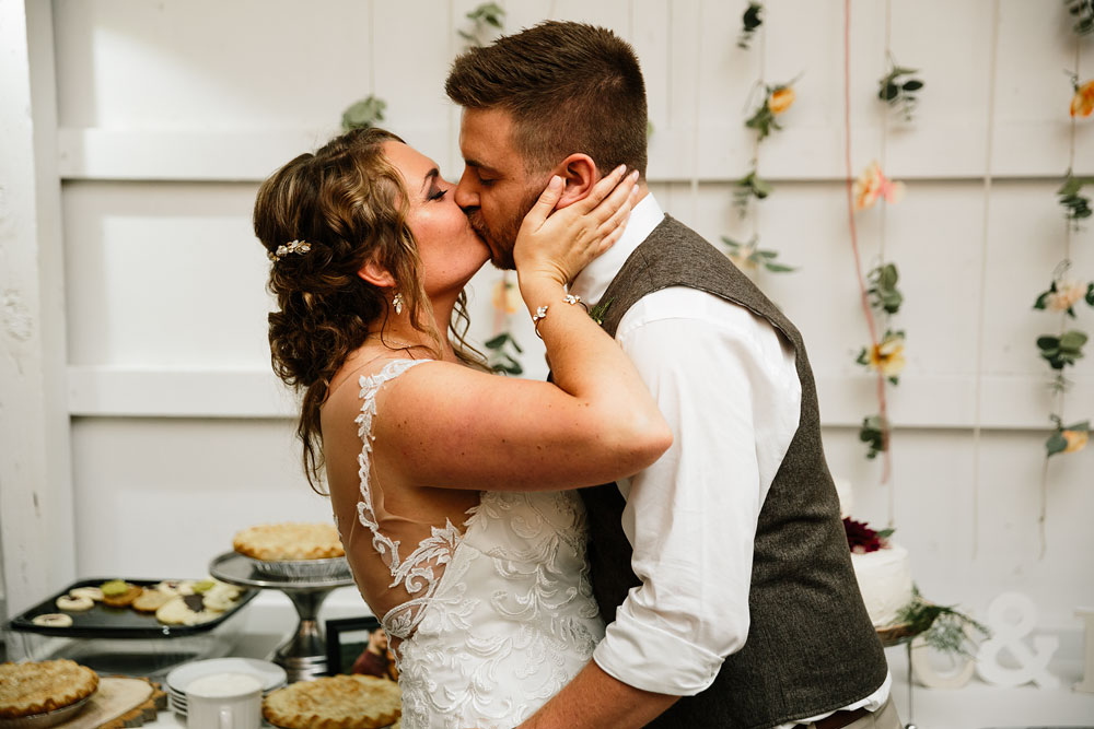 bride and groom kiss at wedding reception at Hines Hill Conference Center in Beautiful Cuyahoga Valley National Park